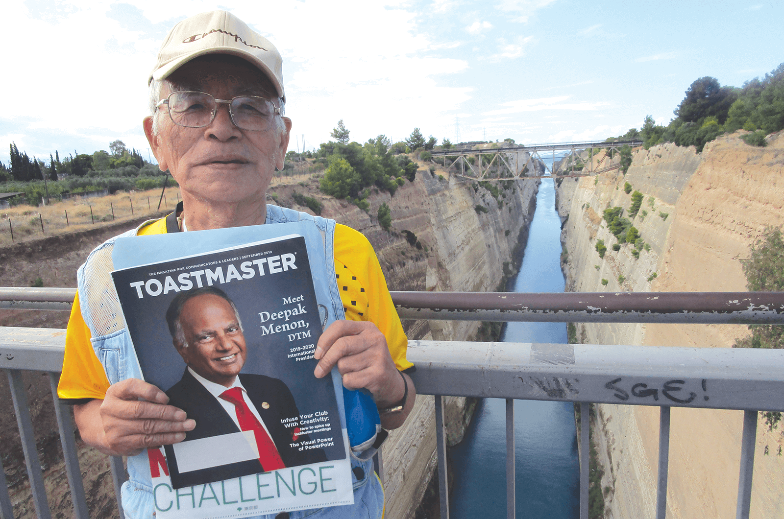 Masatoshi Denko of Tokyo, Japan, stands on a bridge above the Corinth Canal in Greece. The canal connects the Gulf of Corinth with the Saronic Gulf in the Aegean Sea.