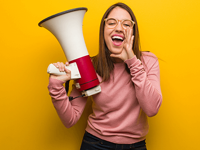 Woman in pink shirt holding megaphone speaker