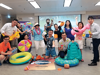 Group of Toastmasters members with beach-themed props