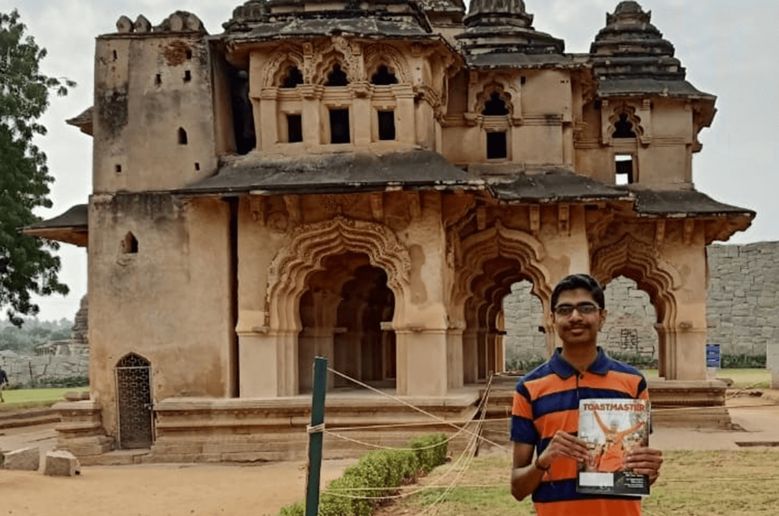 Akash Ravi of Bengaluru, Karnataka, India, visits Hampi, Karnataka, India. In this photo, he stands in front of the Lotus Mahal, where royal families of the Vijayanagara Empire resided.
