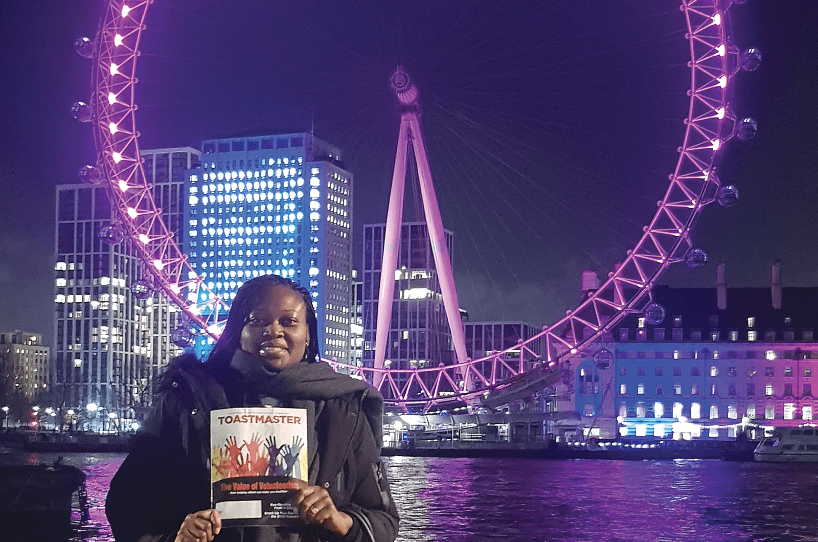 Patricia Dzifa Mensah-Larkai, DTM, of London, England, poses in front of the London Eye, Europe's tallest cantilevered observation wheel, to celebrate her 10th Toastmasters anniversary.