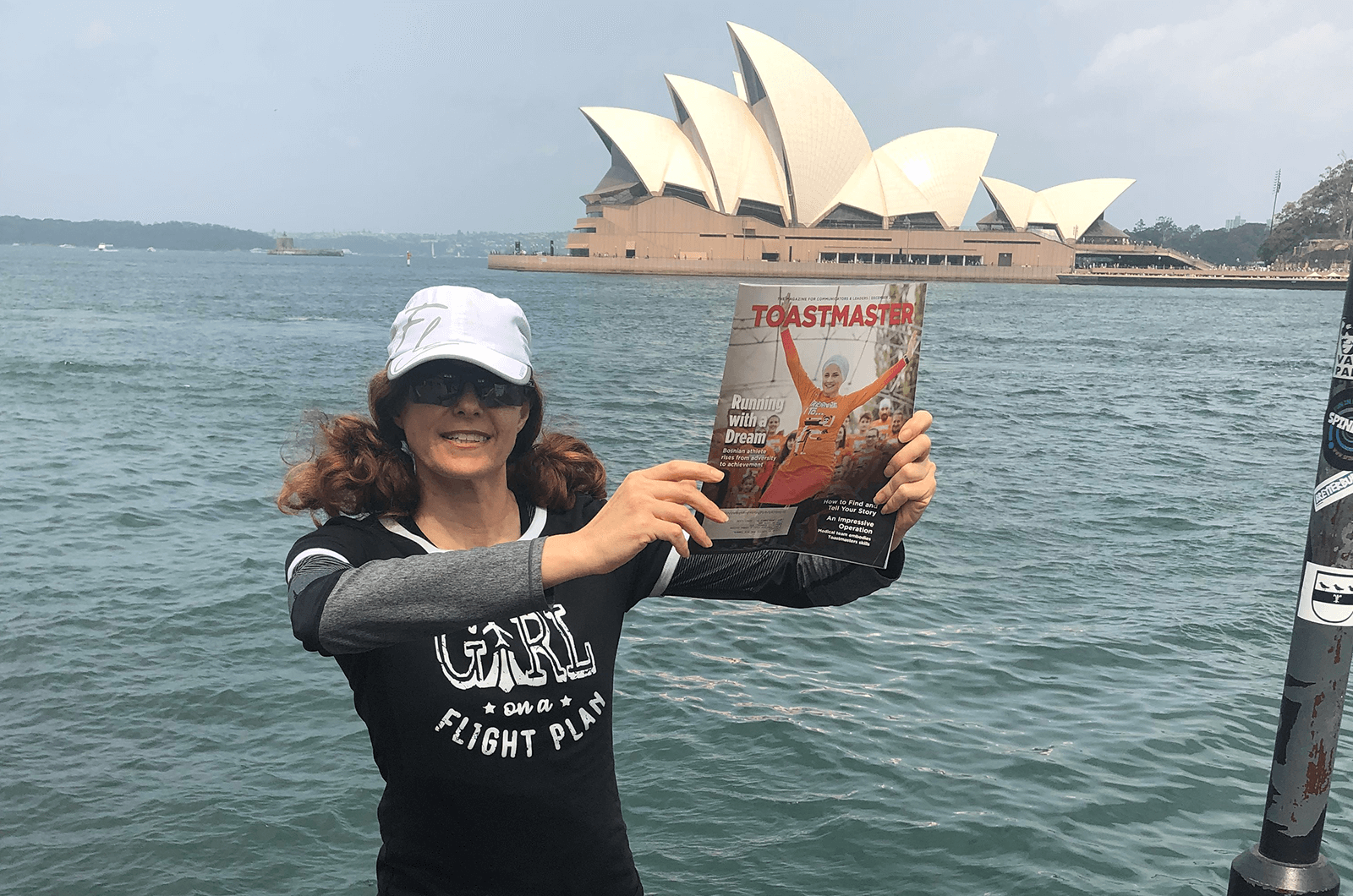 Louisa King of Fort Lauderdale, Florida, stands in front of the Sydney Opera House in Sydney, Australia.