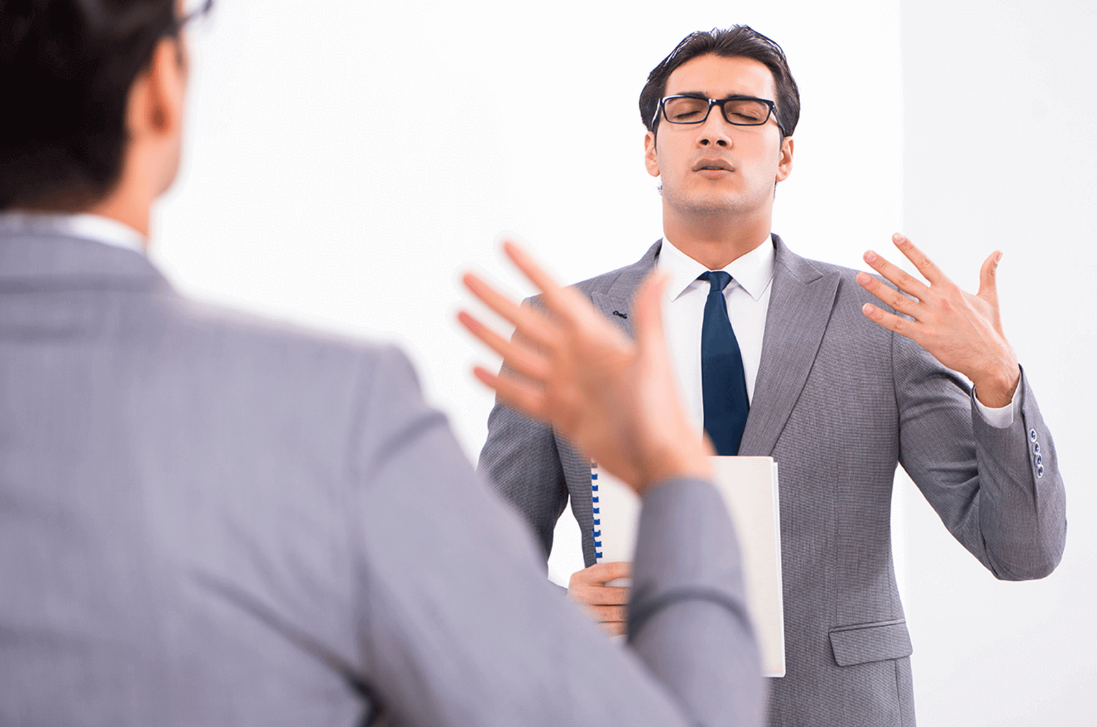 Man looking in mirror warming up for speech