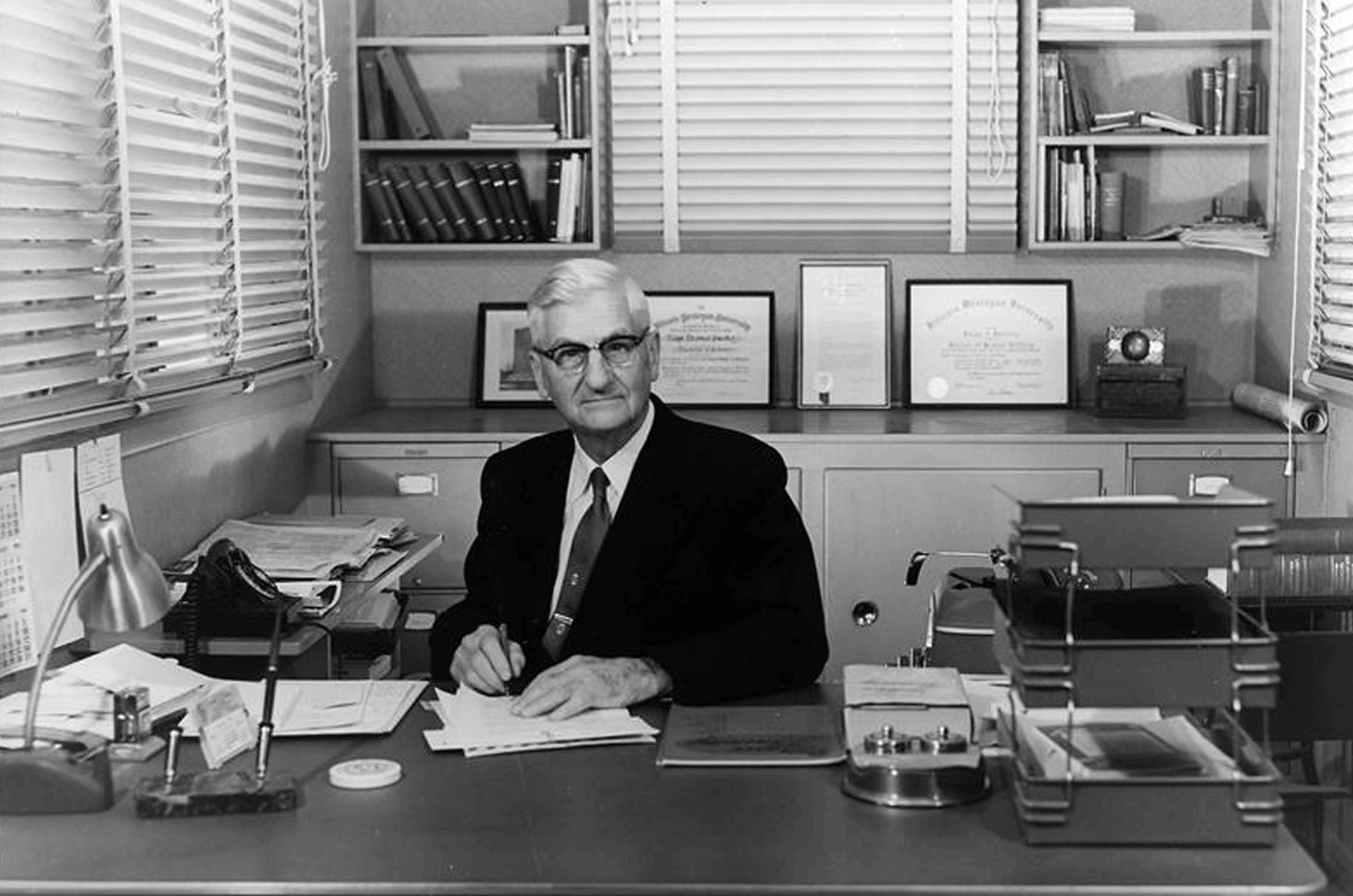 Toastmasters International founder Ralph C. Smedley sitting at his desk