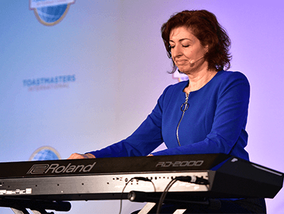 Yelena Balabanova onstage in blue dress