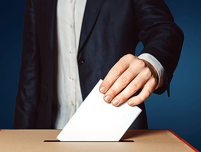 Man dropping piece of paper in ballot box