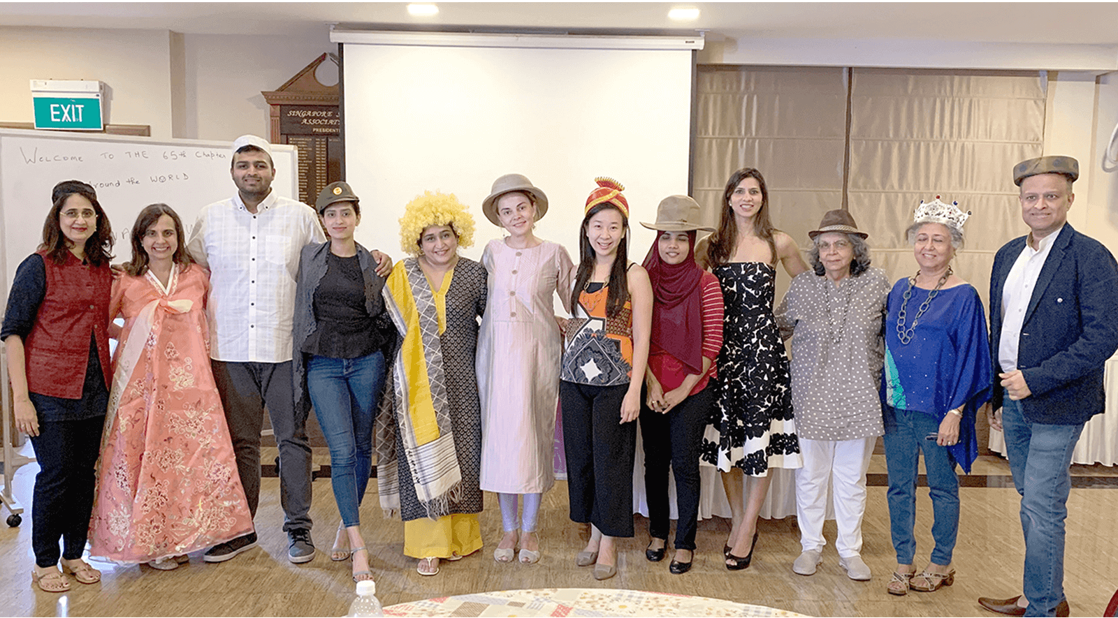 Kauai Toastmasters club gather on red carpet for awards-themed meeting