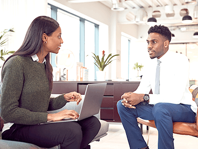 Man and woman sitting down talking during job interview