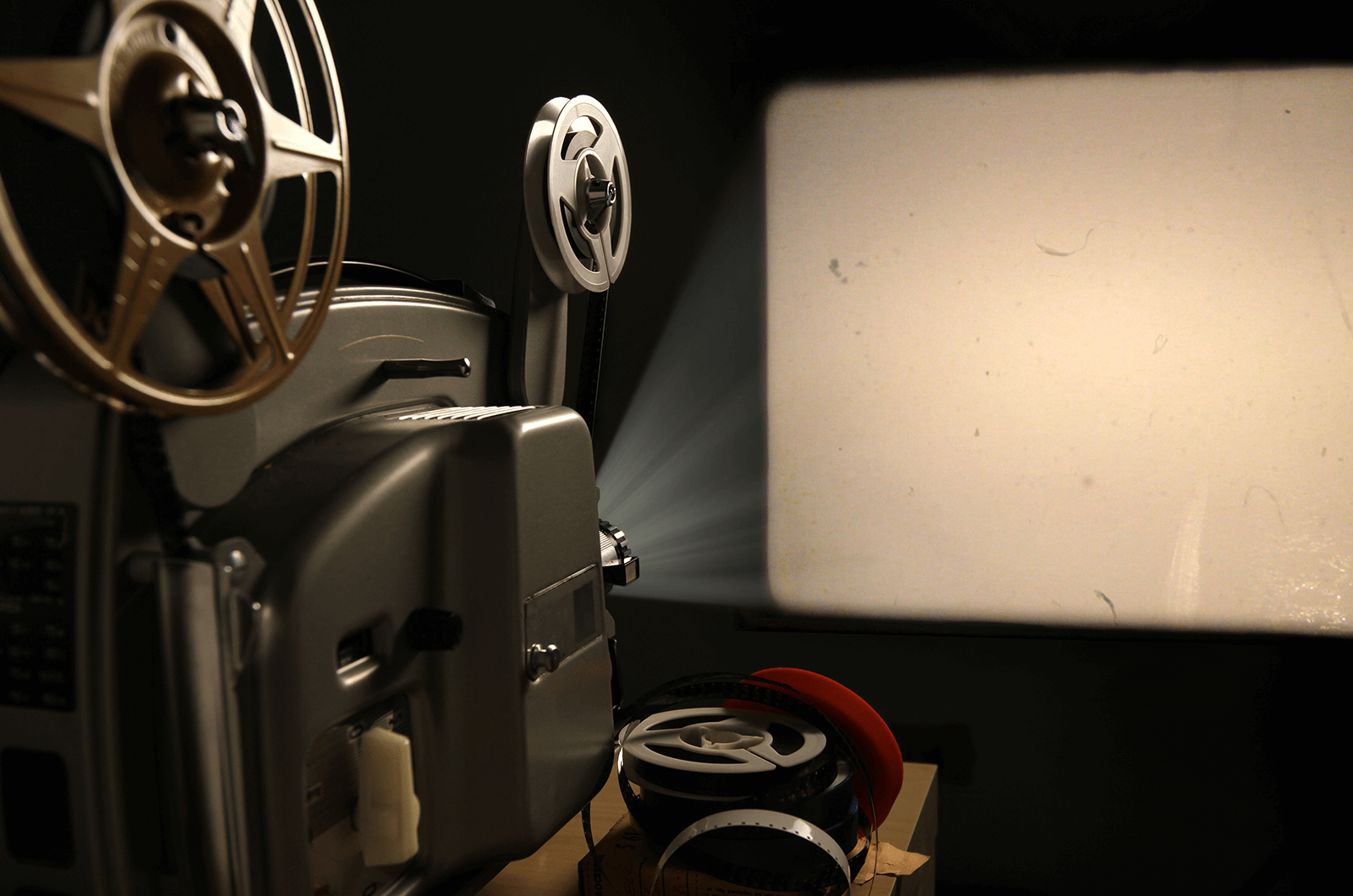 Movie reel showing light on a screen