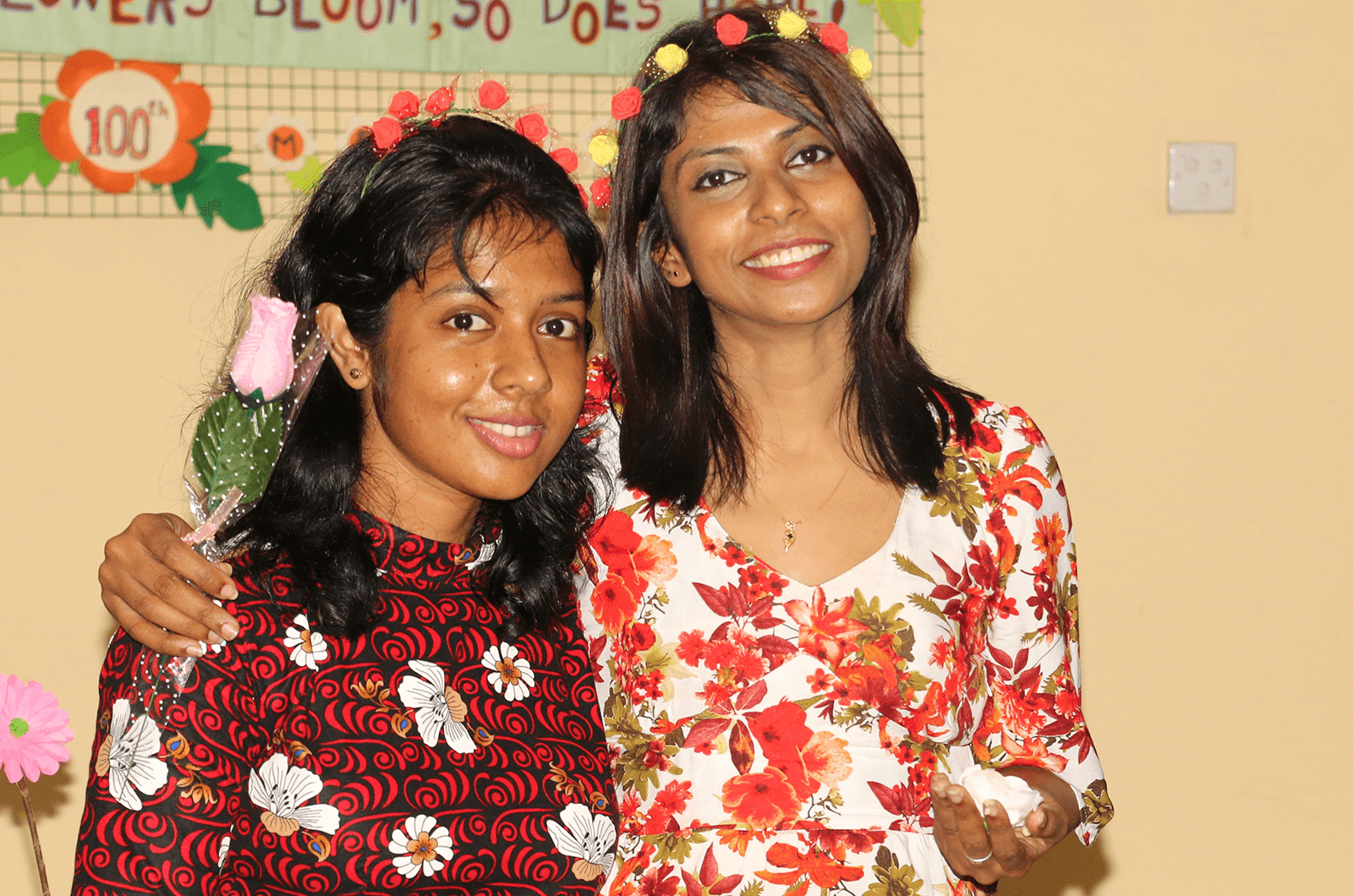 Two women smiling and posing