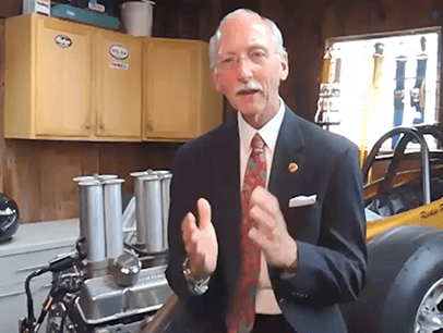 Toastmasters International President Richard E. Peck speaking in his garage
