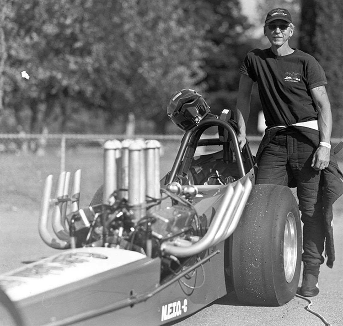Richard Peck posing with his 1963 Front Engine Dragster.