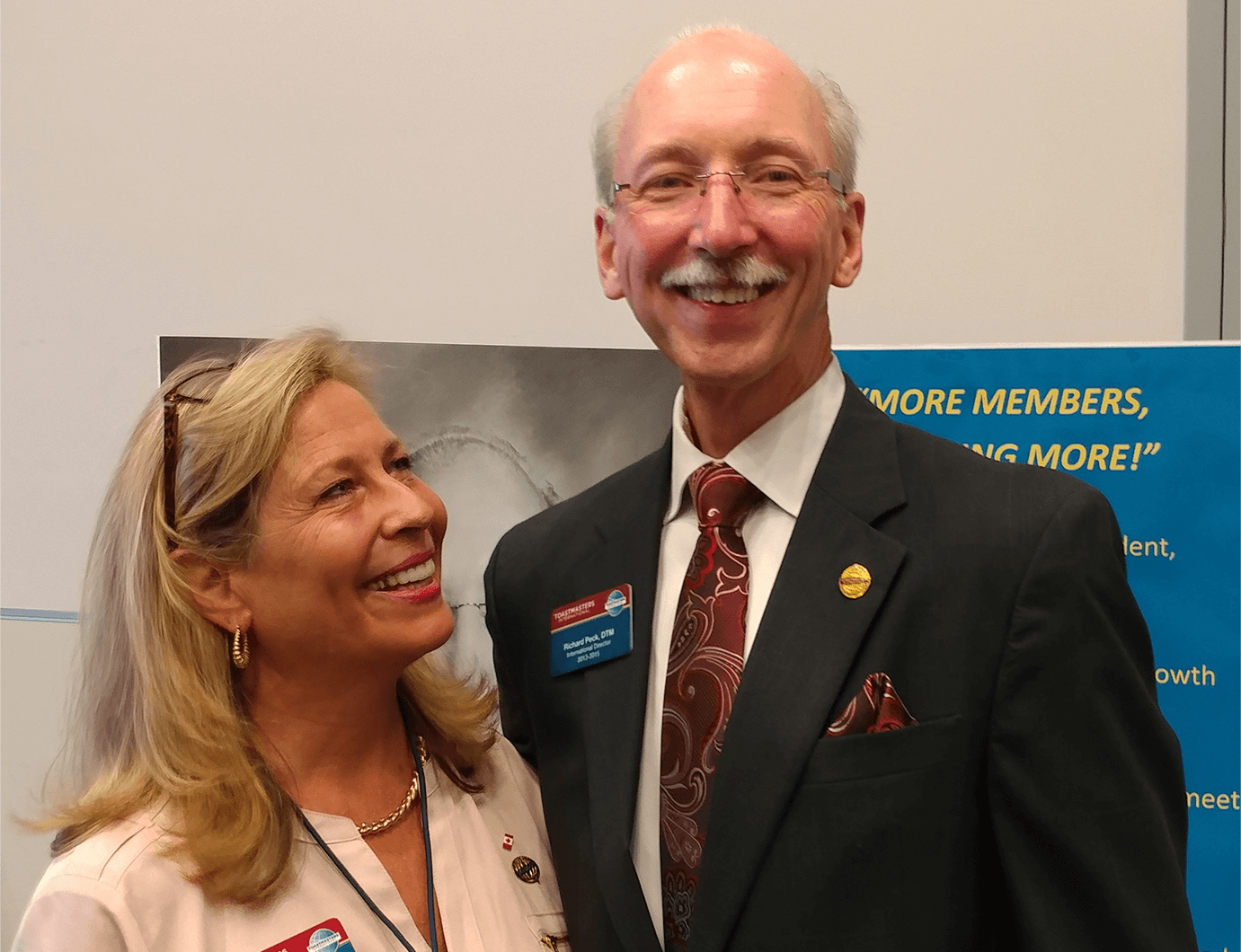 Bettyann Peck, DTM, smiles at her husband, Richard, during a Toastmasters event.