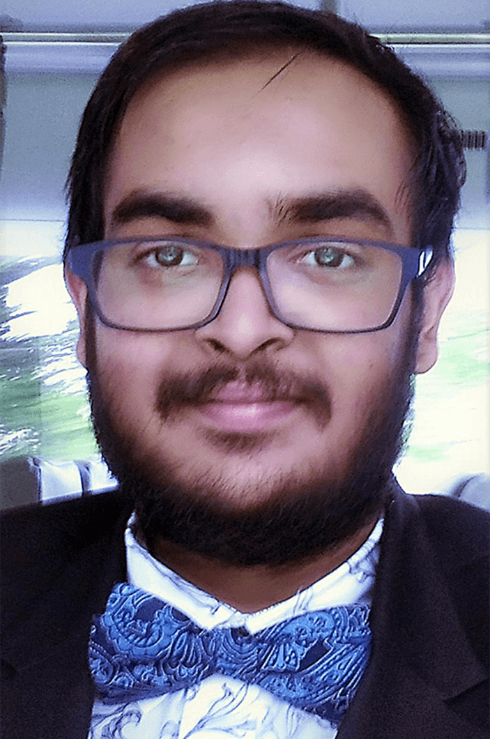 Man wearing glasses and blue bowtie