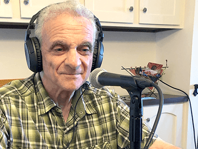 Man wearing headphones with microphone on table