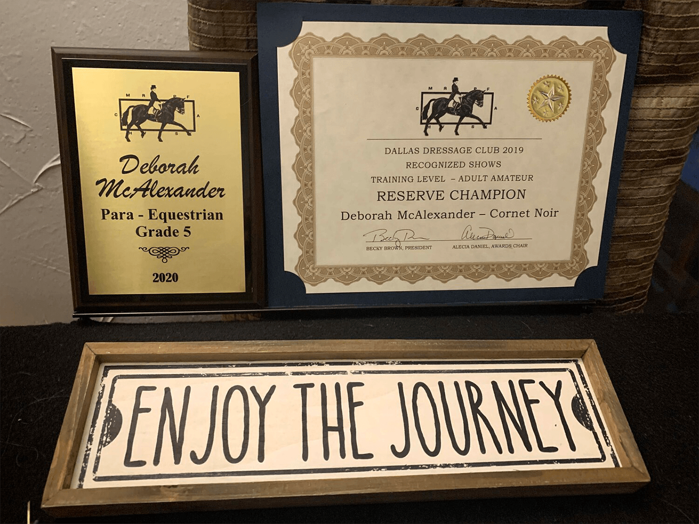 McAlexander displays her accolades from the Dallas Dressage Club Awards Banquet in January 2020.