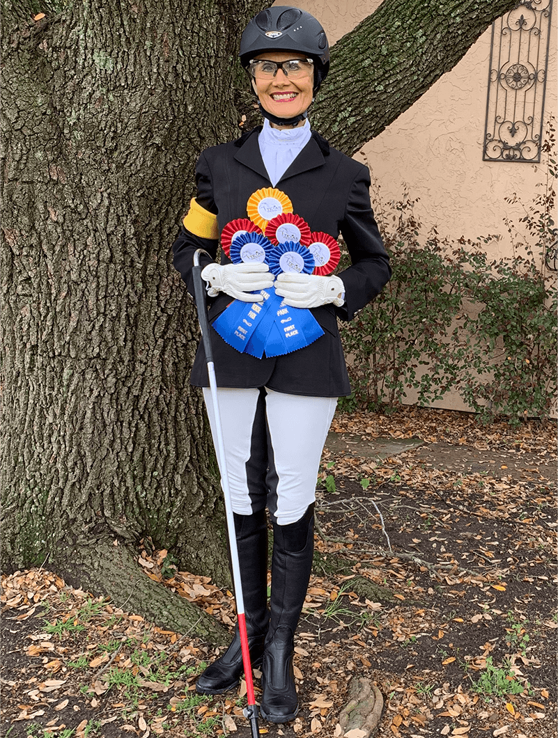 McAlexander smiles proudly with ribbons she won from the Texas Rose Dressage Classic.