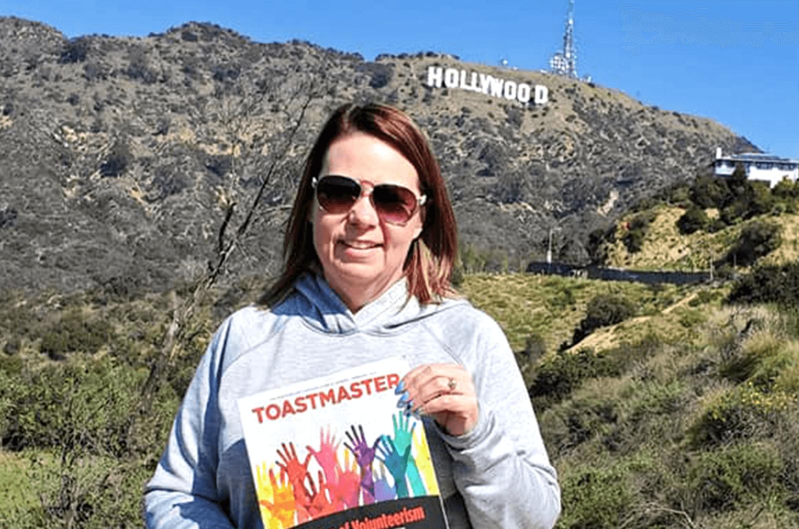 Billie Sutherland, DTM, of Fargo, North Dakota, visits the Hollywood sign in Los Angeles, California.