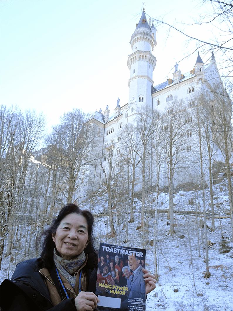 Chizuru Fukunaga of Shimonoseki, Yamaguchi, Japan, stands below Neuschwanstein Castle in Schwangau, Germany. The 19th century castle was intended as a retreat for Ludwig II of Bavaria before he died in 1886.