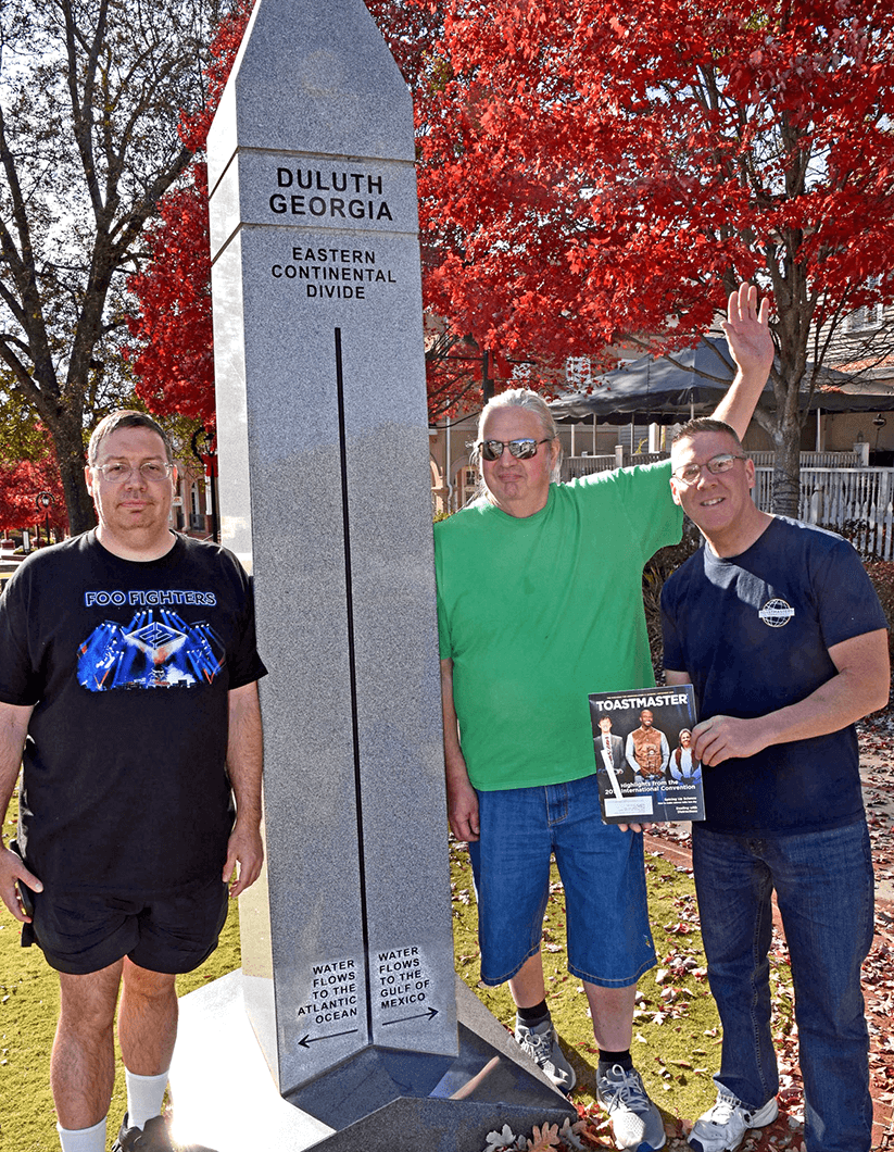 David Gilman, Sam Mercurio, and Tom Weber, DTM, of Waltham, Massachusetts, took a road trip to St. Augustine, Florida, U.S. Along the way, they stopped in Duluth, Georgia, to take a picture with the Eastern Continental Divide monument.