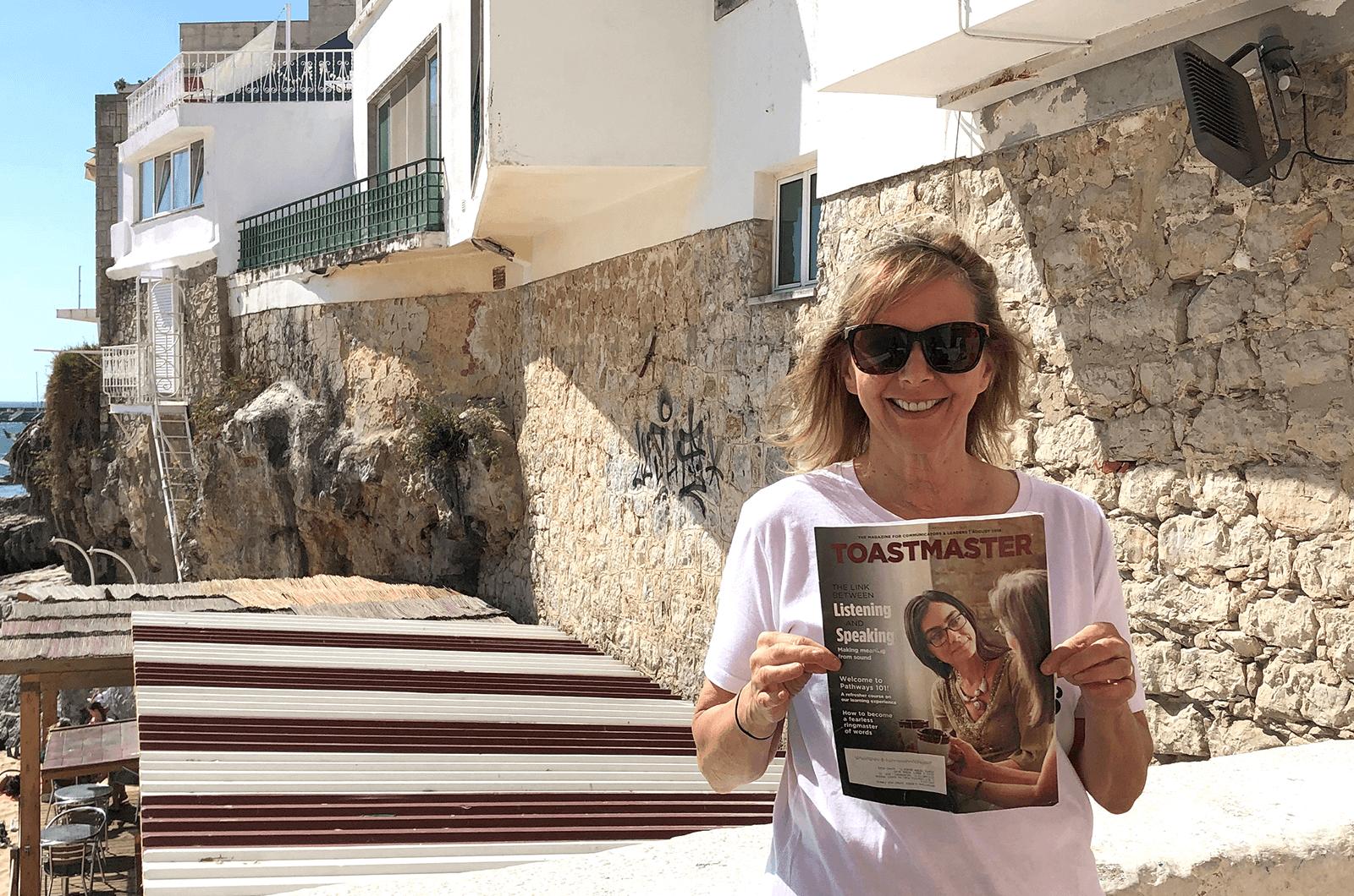 Liz Trendowski of Ponte Vedra Beach, Florida, shows off her Toastmasters pride in Portugal.