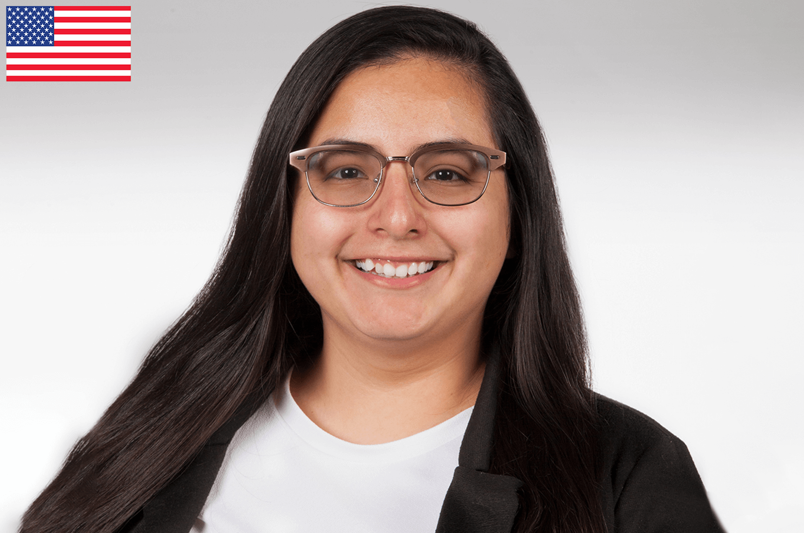 Beatriz Ibara in white shirt and black jacket smiling