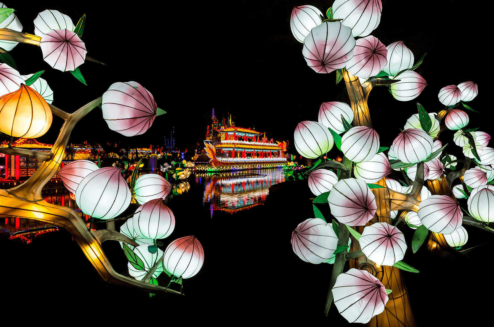 Framed image with lit up dragon boat in background