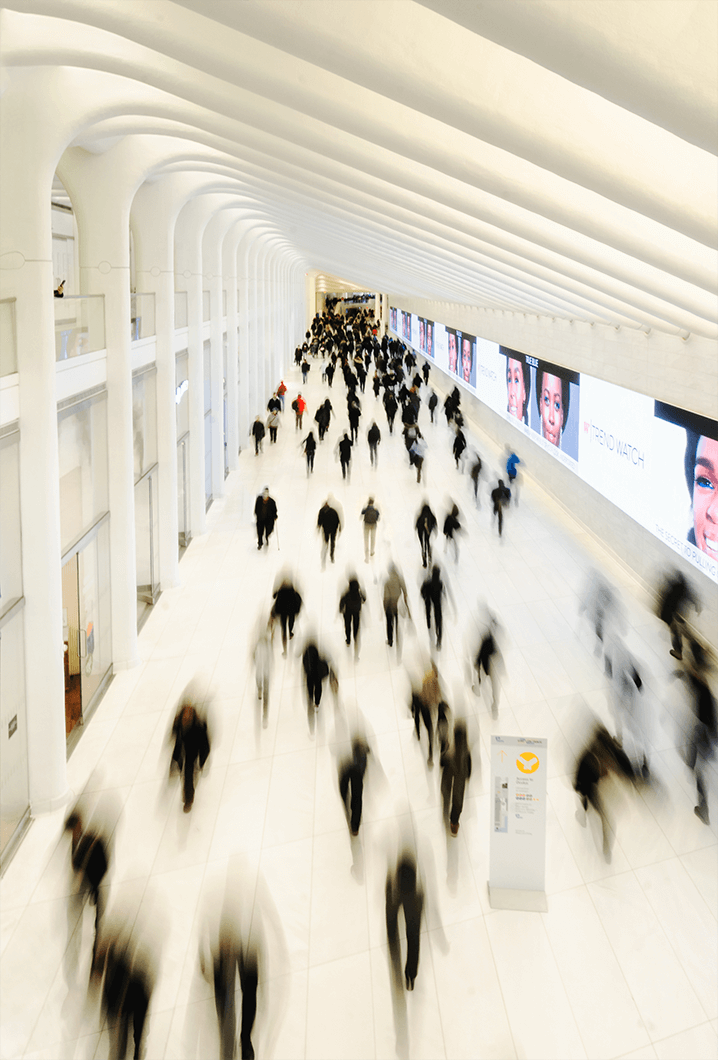 Blurred image of people walking through World Trade Center Station in New York City