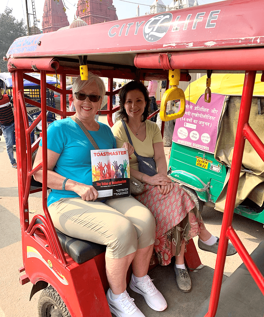 Gail Marsh, DTM (pictured left), of Gambrills, Maryland, and her niece, Jennifer Czapla, DTM, of Amherst, New York, ride in a tuk-tuk in Delhi, India, before the pandemic.