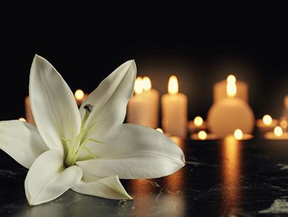 Flower and lit candles