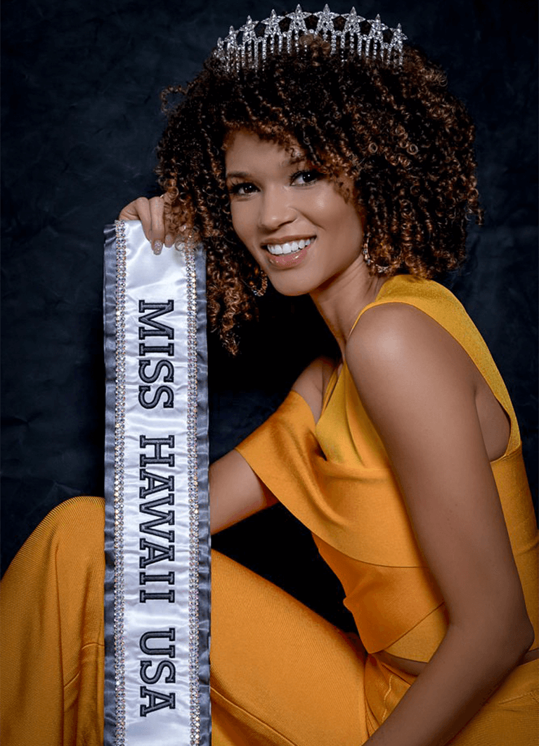 Neyland, posing with her sash and crown, first won Miss Hawaii Teen USA in 2013. At the suggestion of a pageant judge, she joined Toastmasters to improve her speaking and interviewing skills. Photo Credit: Brice Kurihara