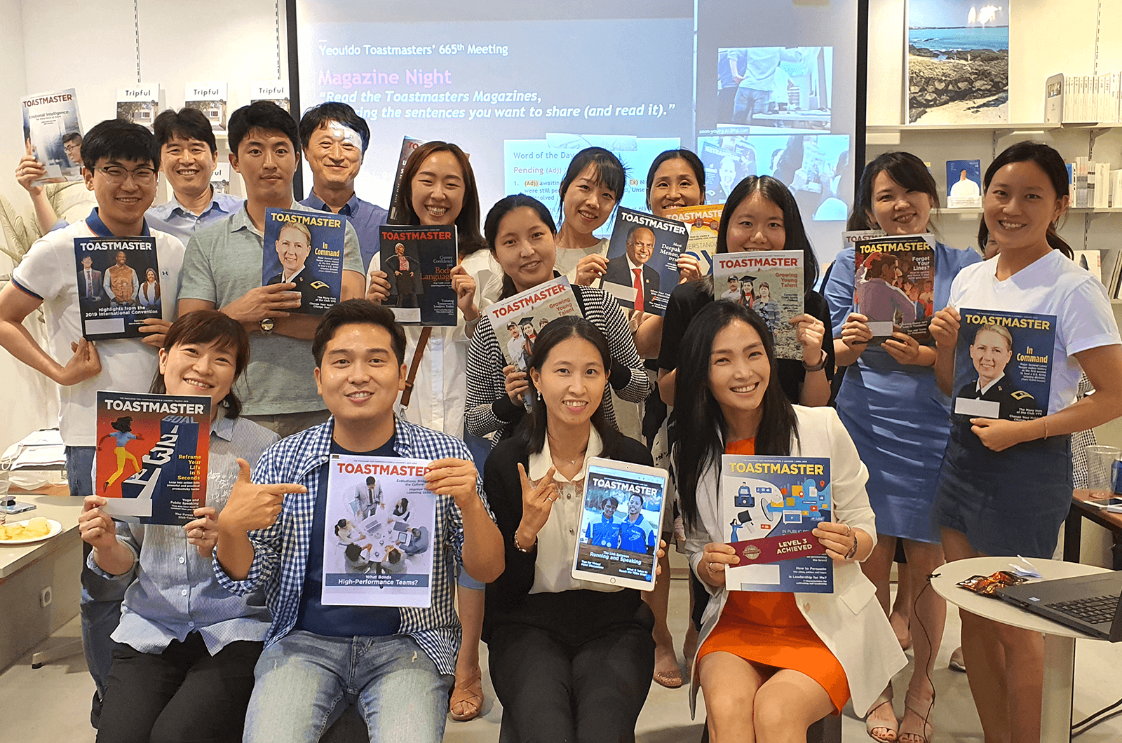 Group of people posing with Toastmaster magazines