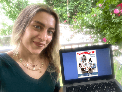 Elaheh Sharafian of Vancouver, British Columbia, Canada, enjoys a Sunday afternoon in quarantine with her online Toastmaster magazine.