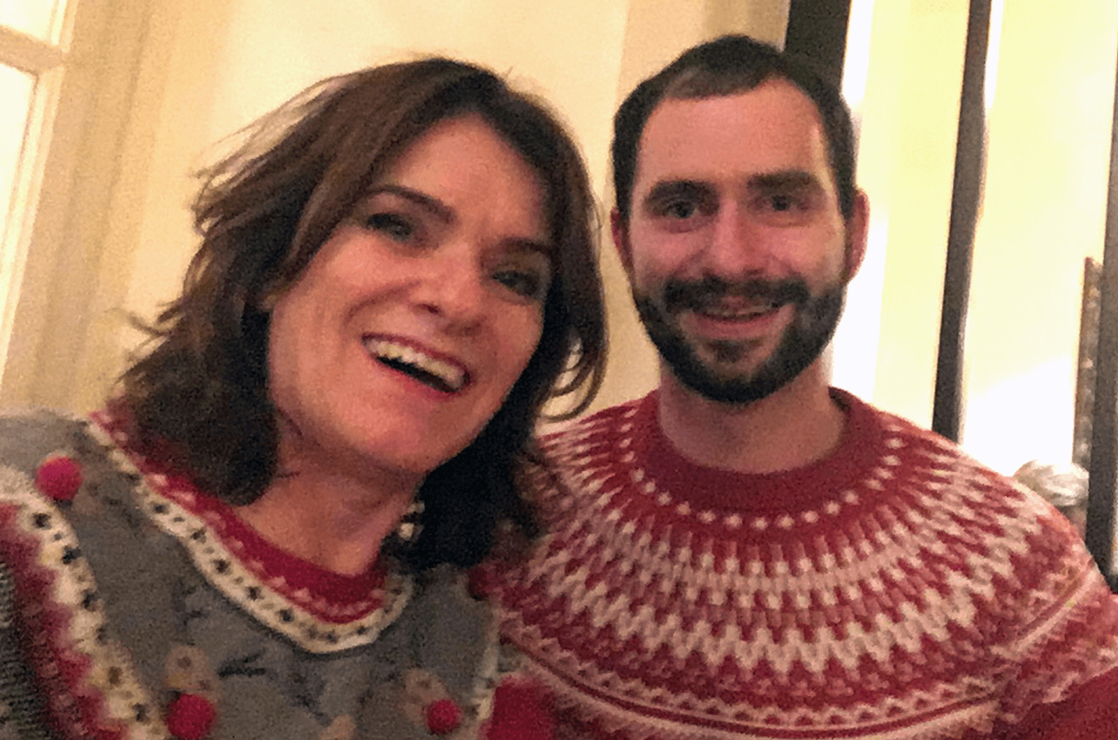 Man and woman posing in sweaters