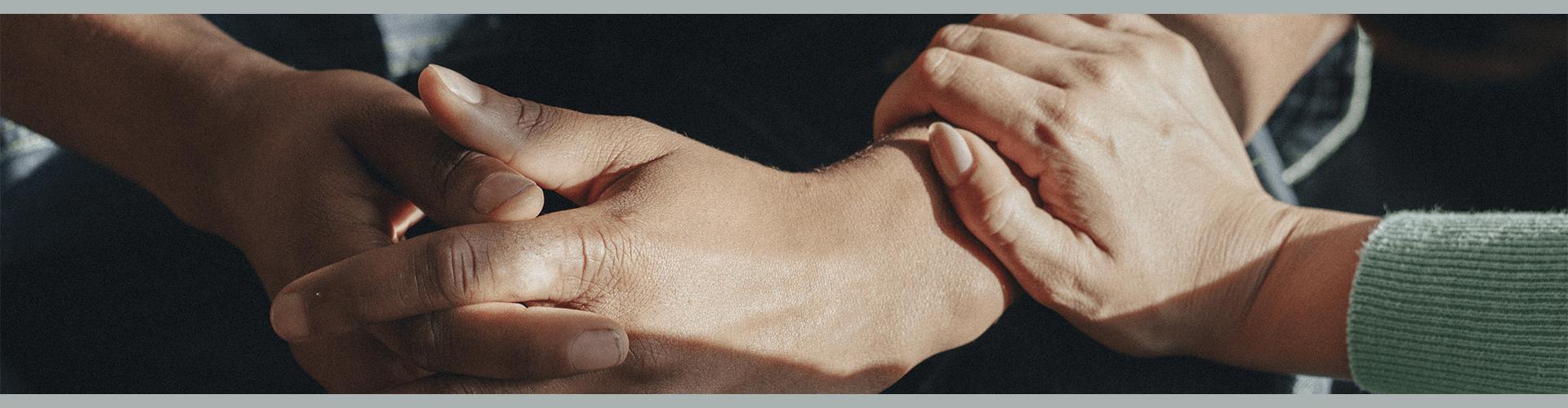 A hand embracing an arm