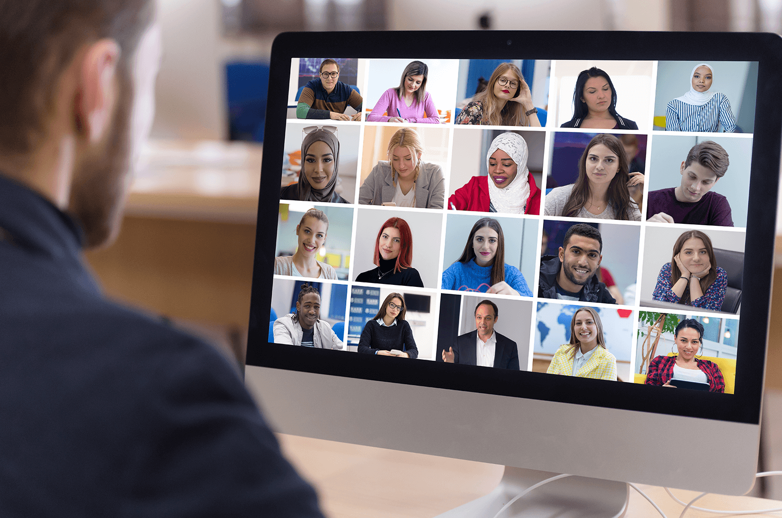 Man meeting with group of people virtually on computer