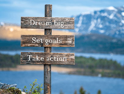 Sign with words dream big, set goals, take action