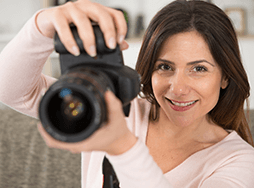 Woman holding up camera to take photo