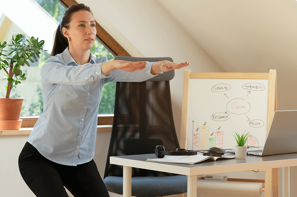 Woman doing a squat in her home office