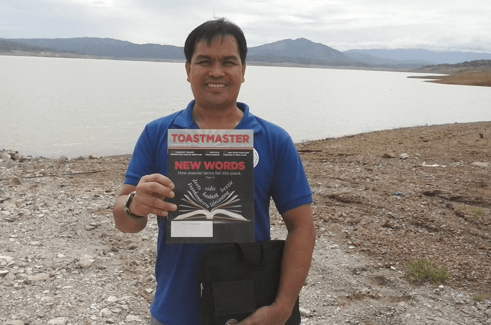 Noel M. Germano of Quezon City, Philippines, takes his magazine on a work trip to do efficiency testing at a power plant in Dupax Del Norte, Nueva Vizcaya, Philippines.