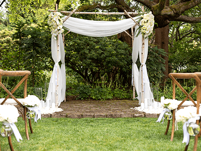 Wedding arch and chairs outdoors