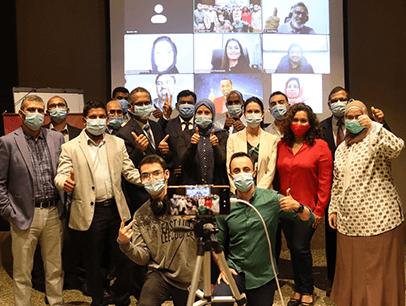 Group of people wearing masks during meeting