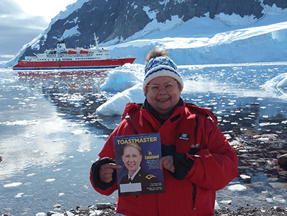 Laverne Wojciechowski,DTM, of Lac du Bonnet, Manitoba, Canada, poses in Neko Harbor, Antarctica, in February 2020.