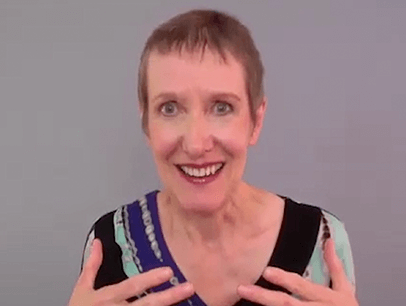 Woman speaking to camera during online speech