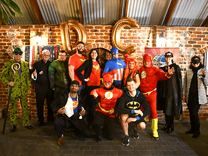 People dressed up in superhero costumes