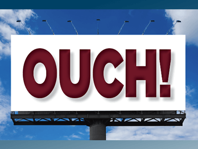 Billboard with the word ouch