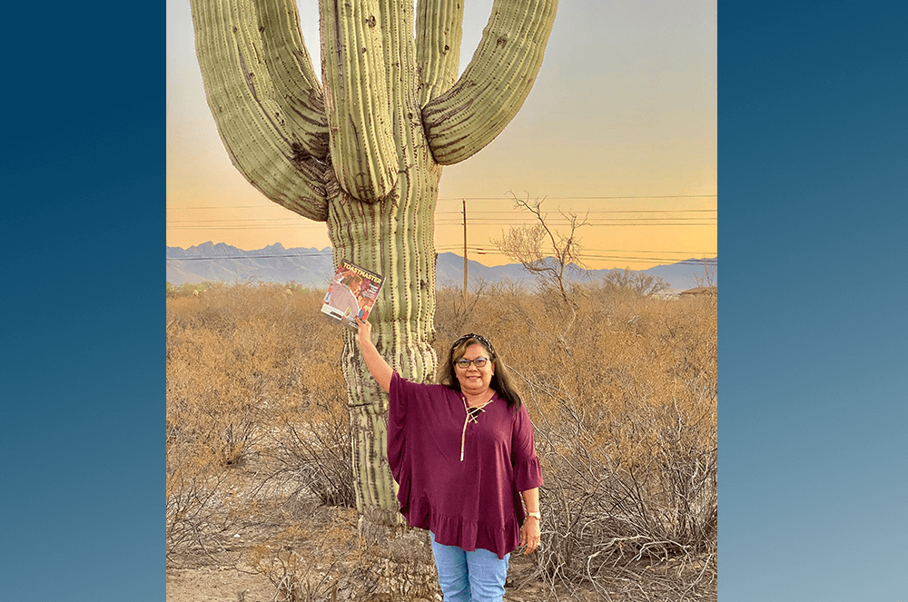 Pim Parpart, DTM, of Melbourne, Florida, shares her Toastmaster magazine with a cactus in Tucson, Arizona.
