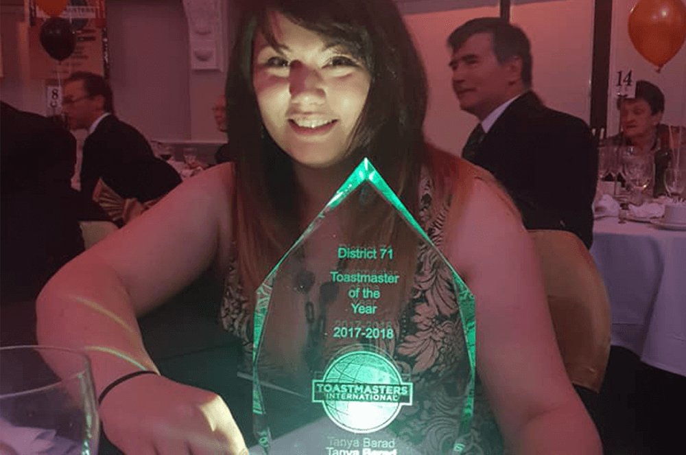 Tanya Barad poses with her trophy after winning Toastmaster of the Year for District 71 in the 2017 – 2018 year.