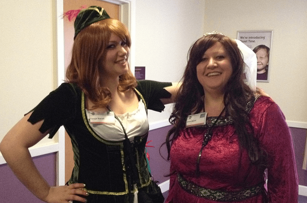 Tanya and her mother, Mish, dress up in costume for a Robin Hood-themed conference.