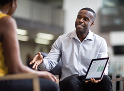 Man giving sales pitch with iPad